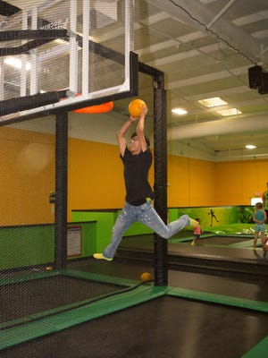 Zabian Arevalo, 15, gets some air on the way to a dunk at Rockin' Jump trampoline park on September 30, 2017.