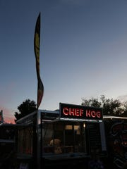 The Chef Hog food truck illuminates the evening at StreetFest in St. George.