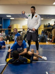 Josh Franzke supervises an exercise during his self defense class Tuesday afternoon. Franzke is a teacher at Ida Baker High School who started a self defense program for its students. The program is in its third year and provides a cross section of training for students including wrestling and jiujitsu among others.