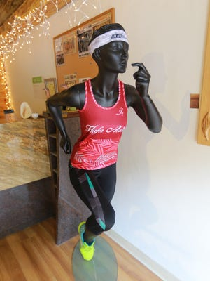Run Guam's apparel for runners is displayed on a mannequin at their store in East Hagåtña .