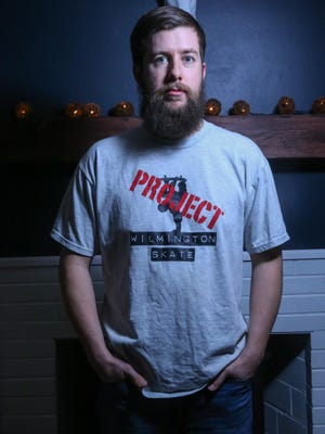 Former skateboarder Jimmy Collins poses for a photo in the Project Wilmington Skate t-shirt he saved in hopes a skate park in Wilmington would be built.