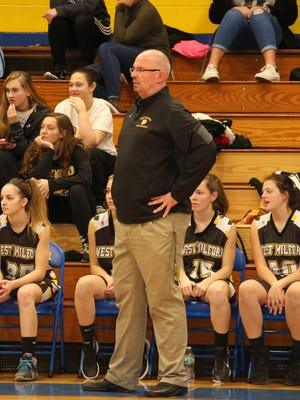 West Milford girls' basketball coach Ray LaCroix won his 200th career game on Wednesday when his Highlanders defeated Hasbrouck Heights in the opening round of the annual Butler Holiday Tournament.