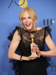Nicole Kidman poses with her award in the photo room at the 75th Golden Globe Awards at the Beverly Hilton on Sunday, Jan. 7, 2018.