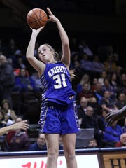 Emma Ronsiek of O'Gorman launches a shot over the Roosevelt