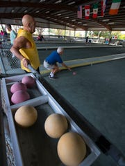 Cape Coral residents Joe Radicchio, left, and Tony Arena play a game of bocce at the courts in Cape Coral's Veterans Park.