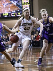 Shelby Selland of Augustana dribbles past the defense