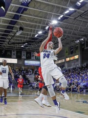 Taylor Gradinjan (24) goes for a layup as NJIT's  Tatianna Torres (22) blocks from behind at Alico Arena on Friday, March 2, 2018.