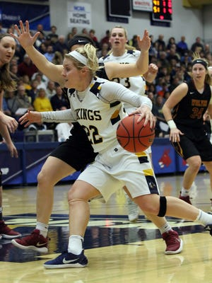 Lynsey Prosser of Augustana drives the lane as Gabby Laimer of Northern State defends during Saturday's semifinal game at the Elmen Center in Sioux Falls.