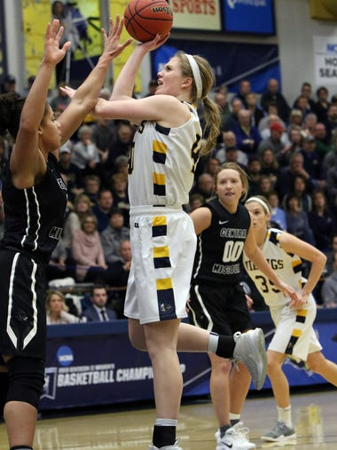 Shelby Selland of Augustana puts up a shot over Kayonna