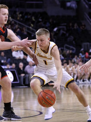 Brady VanHolland of Harrisburg makes his move past Zach Heins of Washington during Thursday's State AA game at the Premier Center in Sioux Falls.