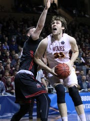 Logan Doyle of Northern State looks to put a shot as