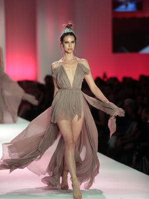 Model wearing Michael Costello's design walks the runway at Fashion Week El Paseo on Tuesday, March 20, 2018 in Palm Desert.