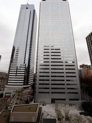 The Russian consulate is located on the 25th floor of One Union Square, right, in downtown Seattle. The United States and more than a dozen European nations kicked out Russian diplomats on Monday and the Trump administration ordered Russia's consulate in Seattle to close, as the West sought joint punishment for Moscow's alleged role in poisoning an ex-spy in Britain.