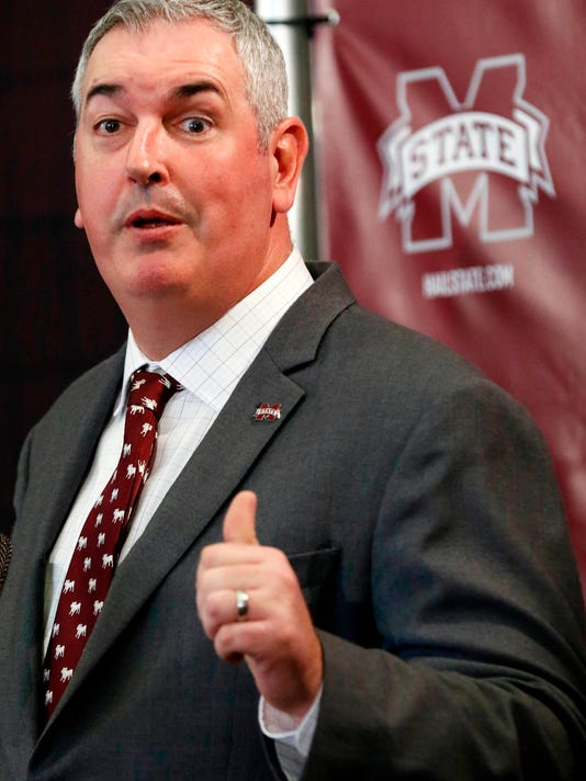 File-This Nov. 30, 2017, file photo shows new Mississippi State football coach Joe Moorhead explaining what he will be looking for in an assistant coach to reporters and team supporters at his official introduction by the university, in Starkville, Miss.  Moorhead is going through the same problems and having the same headaches that first-year coaches always go through when establishing the way they want their football program run. One difference: He won't be given much of a grace period to make it work.(AP Photo/Rogelio V. Solis, File)
