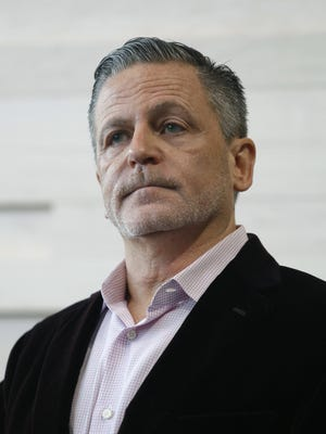 Dan Gilbert speaks during the dedication ceremony for the Gilbert Pavilion and Tom Izzo Hall of History inside Michigan State's Breslin Student Events Center, Friday, Oct. 20, 2017, in East Lansing, Mich.