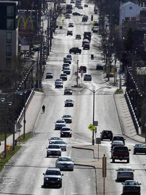 This summer, the City of Milwaukee will reduce the car lanes on the North Avenue (shown looking east) and Locust Street bridges over the Milwaukee River from four to two, creating protected bike lanes.
