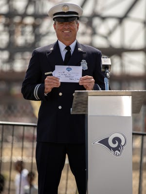 Ventura County Fire Capt. Tom Lanski announced the Los Angeles Rams' 135th overall selection in the 2018 NFL Draft on Saturday at the construction site of the team's future stadium in Inglewood.