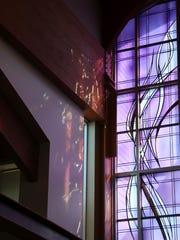 Beveled glass casts light throughout Holy Family Catholic Church.
