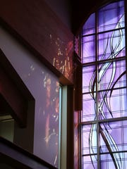 Beveled glass casts light throughout Holy Family Catholic Church.