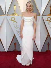 Margot Robbie, an Oscar nominee for her role as Tonya Harding, walks the red carpet for the 90th Academy Awards on March 4, 2018.