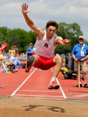 Ty Olejnik of Sussex Hamilton leaps 24 feet 5.75 inches on his final attempt to earn him the boys Division 1 long jump title on Friday.