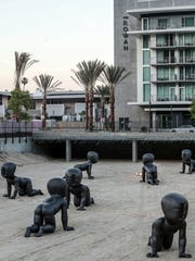 A cluster of baby statues titled Babies by artist David Cerny in downtown Palm Springs Tuesday. The city provided funds in the coming year's budget for a downtown maintenance worker.