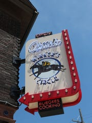 A neon sign marks Oscar's Winner's Circle at 38th and Burnham streets, about a five-minute drive from Miller Park.