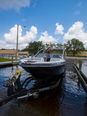 James Ferreira, an employee at Wavetech Powersports, prepares to launch a boat during a water test at the Horton Park boat launch in Cape Coral.