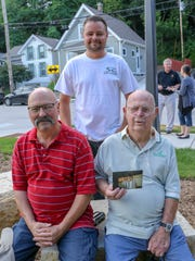 Brad Grimm stands as his dad Ron Grimm and grandpa former Alderman Bernie Grimm sit. A civic garden was dedicated to Bernie and his late wife for years of service to Wauwatosa.