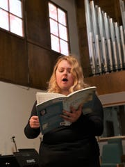 """Vocalist Aralia Vendetti rehearses a solo for """"Stabat Mater,"""" which will be performed March 30-31 at RiverStone Church in Farmington."""