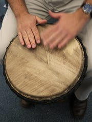 A taut goatskin covers the head of a djembe played by San Juan College music professor Teun Fetz.