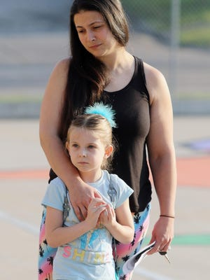 In this file photo, Shayla Deuitch, spends a quiet moment with her 5-year-old daughter, Khloie Long, before making their way to Khole's kindergarten classroom at North Hill Elementary School in Burlington. The Burlington School Board will have some big decisions to make at its July meeting as it considers just how classrooms will look when the 2020-21 school year begins Aug. 24 amid the coronavirus pandemic.