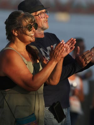Christine and Karl Jennings, fans of Blues music, enjoys the performance of Bluzillion during Friday Fest July 3 along the Burlington riverfront in front of Memorial Auditorium.
