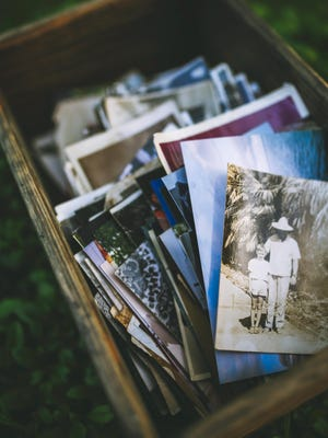 Sorting through photos can be a daunting task. Experts recommend that you start slowly.