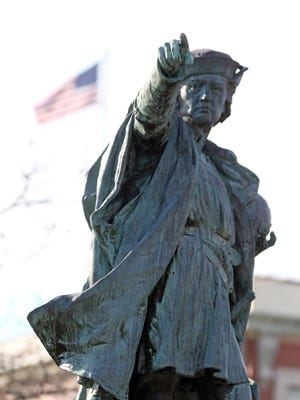 Three people, including a Pawtucket teacher, are charged with defacing a statue of Christopher Columbus at the corner of Elmwood and Reservoir avenues in Providence.