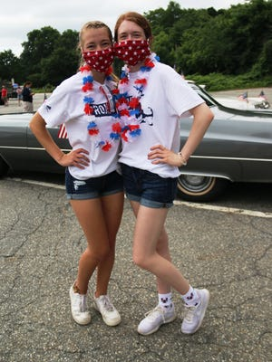 Katy Mangus, left, and Jordan Stanley arranged the patriotic and festive 4th of July car parade in Paxton. The Project 351 alumni have done weekly neighborhood events and projects to spread some cheer during the pandemic.
