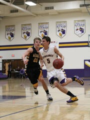 Kewaunee junior Logan Brusky moves around Algoma senior Hunter Prokash during a February game..