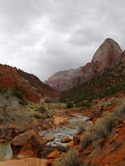 The Virgin River flows through Zion Canyon under cloudy skies. A new book features the best writing about the Zion Canyon area.