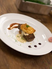 """A cumin and roasted garlic-scented buffalo scrapple served with smoked bacon and sausage gravy, crispy egg and fresh salsa was on the menu at the 2014 MidAtlantic Wine & Food Festival's """"Scrapplegasm"""" event."""
