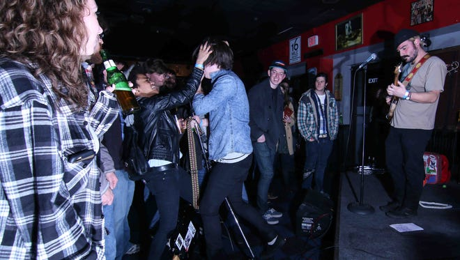 Wilmington rock band Tracy Chapstick's lead singer Landon Maloney goes intro the crowd at 1984 bar in Wilmington last year. The band returns for a show Friday night at 1984 and Oddity Bar.