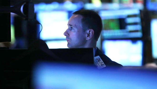 A trader works on the floor of the New York Stock exchange on August 16, 2013.