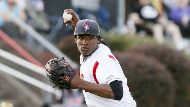 Volcanoes Melvin Adon throws to first in a game against Vancouver on Tuesday, July 5, 2016.