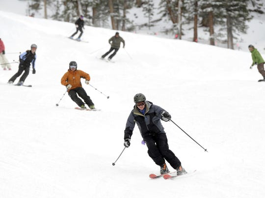 Skiers turn on some fresh Colorado snow. Snowpack in the Colorado mountains where the headwaters of the Rio Grande form is about 135 percent above median levels.