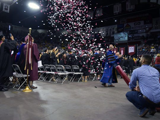 NMSU engineering students fire confetti cannon at commencement ceremonies at the Pan American Center