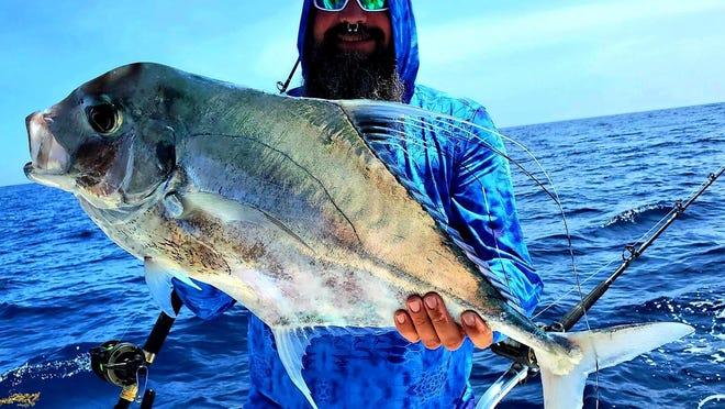 Ricco Semento, who was visiting from Chicago, caught this monster 32-  pound African pompano about 35 miles out of Ponce Inlet.