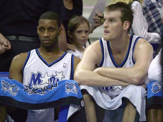 Pat Garrity, right, sits next to Tracy McGrady in 2003.
