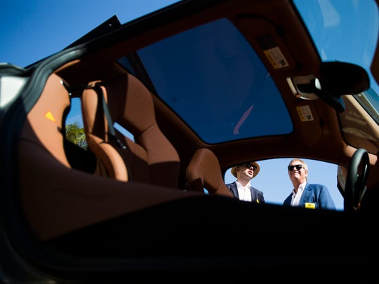 "Abe Quigley and Lee Arnold look at the 2017 McLaren 570GT up for bid with lot 49 during the 2017 ""Bright Sunshiny Day"" Auction at the Naples Winter Wine Festival on Saturday, January 28,  2017 at the The Ritz-Carlton Golf Resort in North Naples."