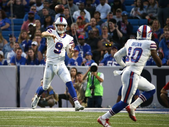 Bills quarterback T.J. Yates hits Philly Brown in the