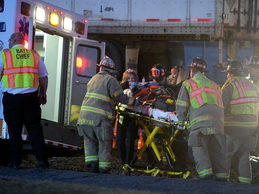 Emergency crews tend to a 16-year-old male that was struck by a Norfolk Southern train near the 7th Street crossing around 6:42 a.m., Friday, March 13, 2015. The boy later died of his injuries. Jeremy Long -- Lebanon Daily News