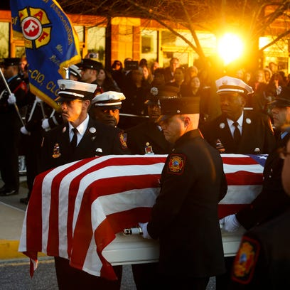 The casket of Wilmington firefighter Ardythe Hope is